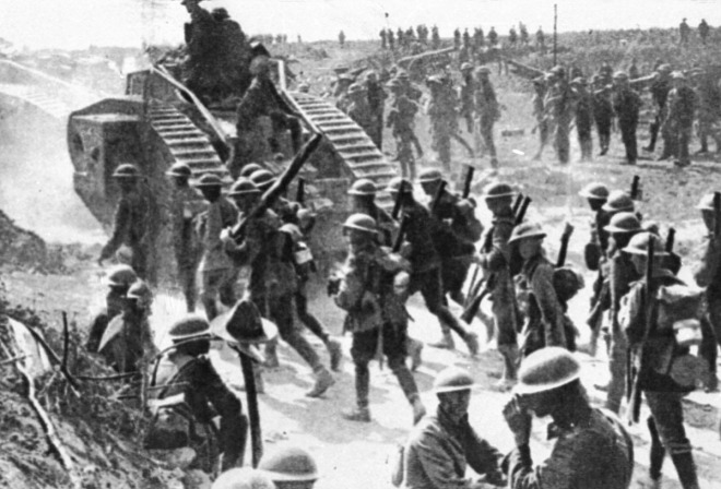 Soldiers follow a British Mark IV tank